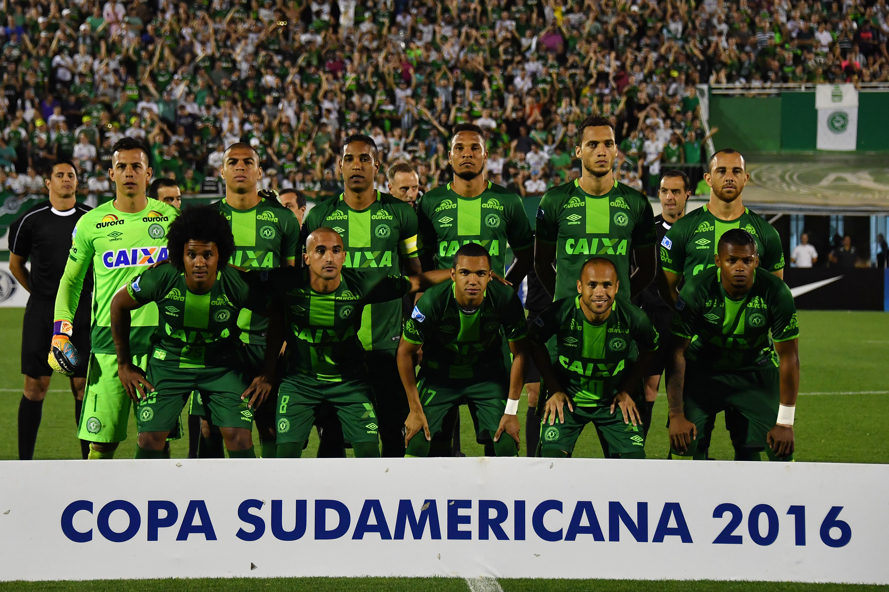 (FILES) This file photo taken on November 23, 2016 shows Brazil's Chapecoense players posing for pictures during their 2016 Copa Sudamericana semifinal second leg football match against Argentina's San Lorenzo  held at Arena Conda stadium, in Chapeco, Brazil.A plane carrying 81 people, including members of a Brazilian football team, crashed late on November 28, 2016 near the Colombian city of Medellin, officials said. The airport that serves Medellin said that among the 72 passengers and nine crew were members of Chapecoense Real, a Brazilian football club that was supposed to play against Colombia's Atletico Nacional Wednesday in the South American Cup finals.   / AFP PHOTO / NELSON ALMEIDA